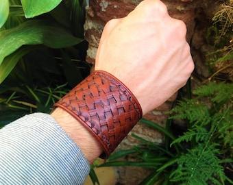 Reddish brown leather cuff bracelet handstamped with basketweave pattern
