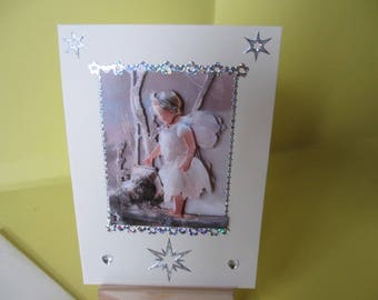 Card 3D (relief) small girl Elf with silver stars