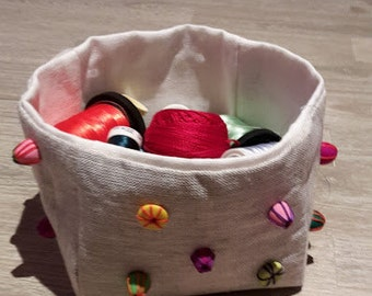 Hand made linen storage basket embellished with hand made beads.