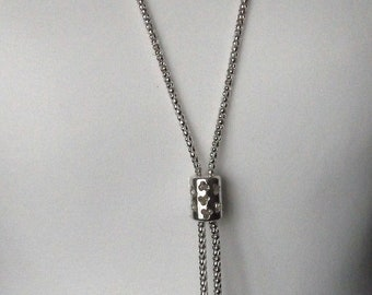Silver tone long lariat style drop necklace with diamantes.