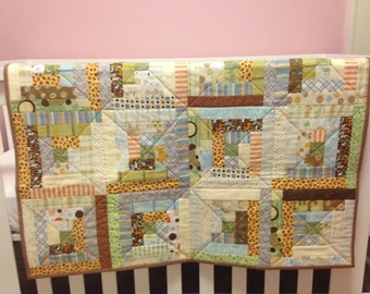 Yellow, Blue, Green, and Orange Jungle Scrappy Log Cabin Baby Quilt