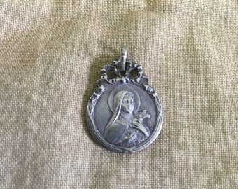 Art nouveau religious pendant . Very pretty and organic .silver french
