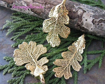 One 24KT Gold Dipped Lacey Oak Leaf Pendant