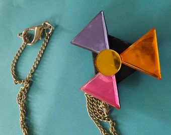 """A """"windmill"""" necklace---Made from a shiny acetate plastic colored pin!"""