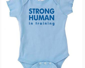 Strong Human In Training Gender Neutral Baby Clothing