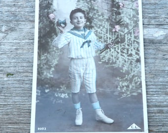 Vintage 1900s recolored French postcard  boy playing Diabolo game