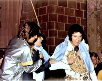 Elvis Presley , Elvis on stage during his last tour in 1977