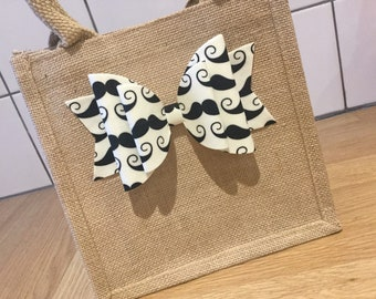 small jute lunch bag with moustache felt backed fabric or chunky glitter bow.