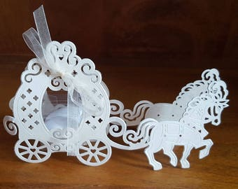 Wedding favours.Horse carrige paper favours