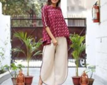 marsala  and beige ensemble of flared ikat top and  beige tulip pants