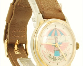 Rain Bird vintage wrist watch, 7 Jewels, yellow gold plate & stainless steel round water resistant case