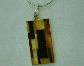 A mosiac of inlaid agate rectangles in a sterling setting