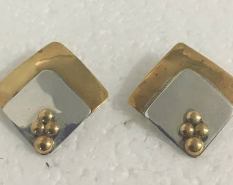 Sterling silver and brass square stud earrings with brass accents