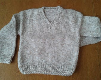 Hand knitted baby jumper
