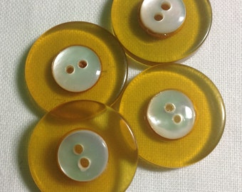 Four Vintage Apple Juice Bakelite Buttons with MOP Centers