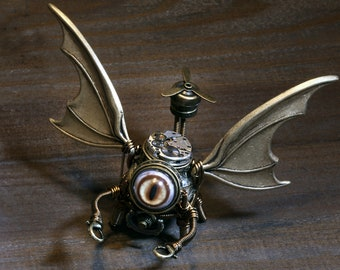Flying Robot Minion with taxidermy glass eyes and propeller