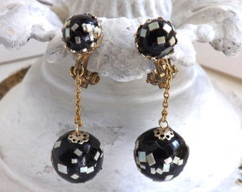 Vintage 1960s black confetti beaded dangle earrings gold tone clip on black beads with mother of pearl chips made in Japan