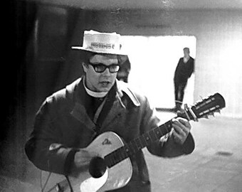 Gospel Music. Black and White Photograph of vicar in straw hat playing guitar during student Rag Week in Birmingham 1967/68