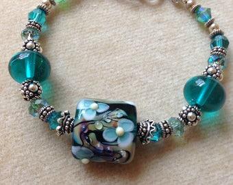 Sterling Silver, Teal Flower Lampwork Focal, and Swarovski Crystal Bracelet 611