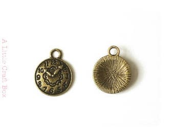 Small clock - 5 charms bronze