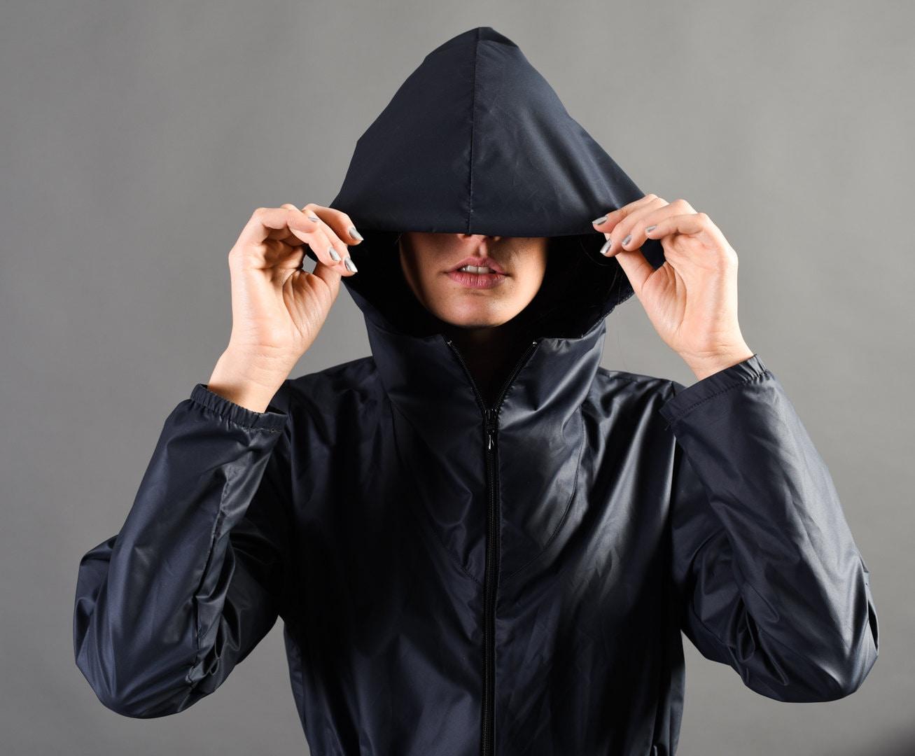 Description. WE LOVE FUSS is a raincoat, windbreaker with hoodie, designed  for women.
