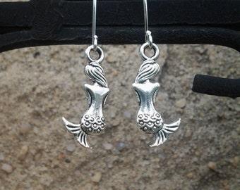 Silver Mermaid Earrings. Mermaid earrings hang from silver plated surgical steel earwires.