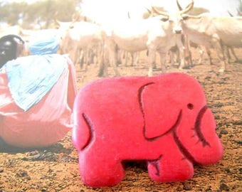 x 1 red Howlite elephant pendant bead.