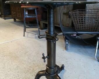 Vintage industrial cast iron adjustable end table.