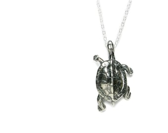 Solid sterling silver turtle pendant or charm with antique patina.