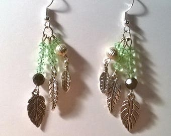 Earrings made of green and black crystal and leaf charms