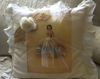 A shabby chic ruffle  cushion with a ballerina