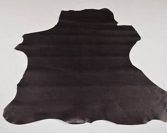 Black calfskin leather with purplish reflections