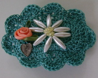 Crocheted Green Motif is Adorned with Beaded Daisy, Charm, and Ribbon Rose Mounted on a Barrette
