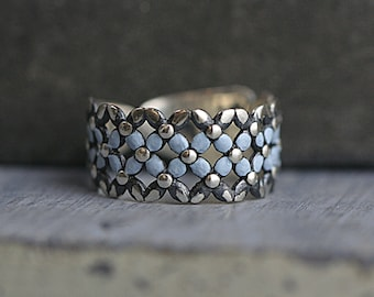 Sterling silver Forget me Not ring. Filigree ring with light blue enameled trim. Partly oxidized. Adjustable. Bridesmaid ring.