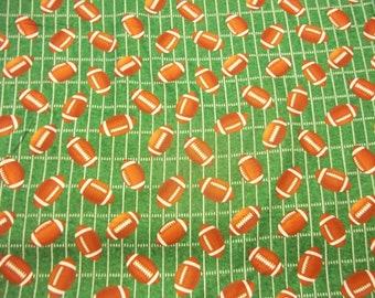 "FOOTBALLS on GREEN  Backround 100%  Cotton  fabric  One  1 Yard piece 36"" x 44"""
