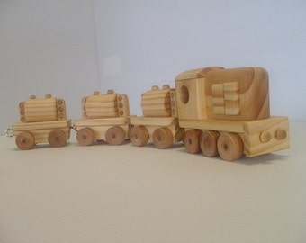 Wooden toy train with diesel locomotive and three tank cars.