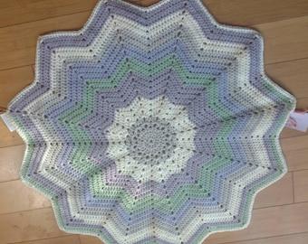 Handmade 30in round crochet baby blanket.