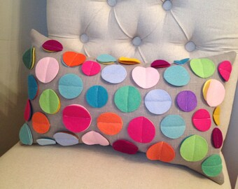 Rainbow disc pillow on grey linen
