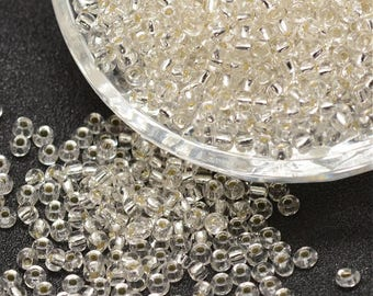lot 10g 8/0 seed beads: 2.8-3.2 mm silver rainbow clear