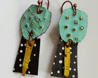 Punched aqua marine tin earrings with black and white polkadots and yellow