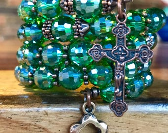 Handmade 5 decade rosary wrap bracelet with faceted green glass beads and tibetan copper. Five decade memory wire cuff.