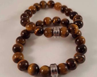The special gemstone bracelet for him made of eye and stainless steel