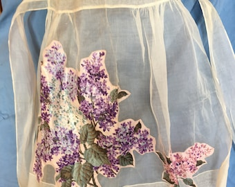 Vintage hostess apron,  sheer with lilac appliqué and pocket