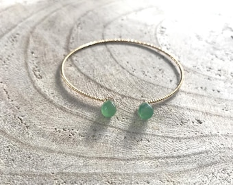 Gold Bangle is twisted, green agate drops