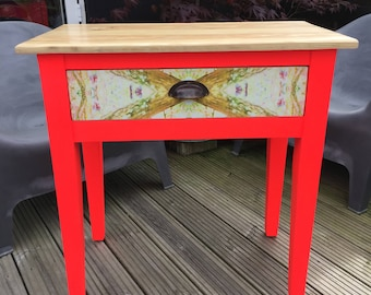 Upcycled console/vanity table in neon red with decoupaged drawer & beeswaxed top.