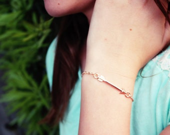 Rose gold Arrow bracelet. Simple and delicate. rose gold arrow charm.