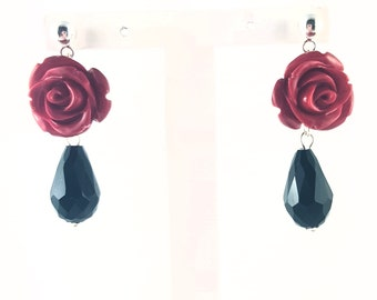 Red rose earrings with faceted glass teardrops.