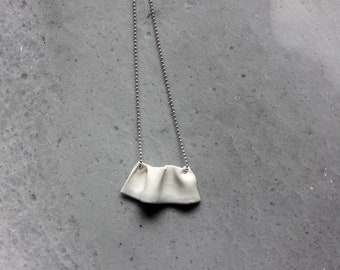 Handmade ruffle porcelain necklace on a long silver chain