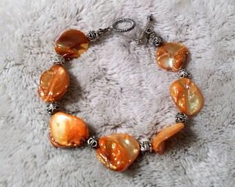 Orange pearl beaded bracelet