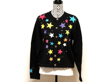 Vintage Women's ugly black beaded Star Christmas sweater size large by Jack B. Quick
